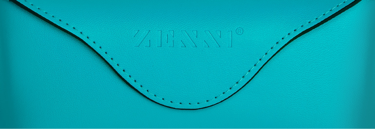 Deluxe teal case with embossed Zenni logo.