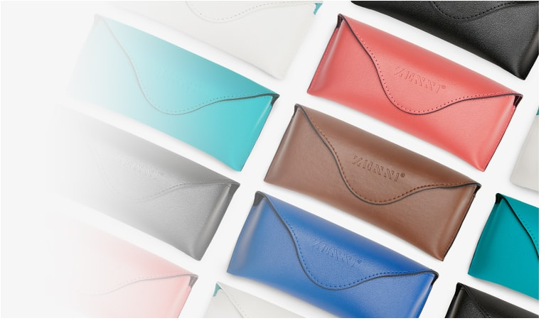 Array of deluxe vegan leather cases with embossed Zenni logo shown in Zenni teal #A50100024, royal blue #A50100016, pink #A50100019, brown #A50100015, black #A50100021, and white #A50100030.