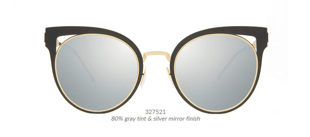 Fashion-forward, gorgeous cat-eye sunnies with flat metal front and striking cut-out detail on the corners. Shown in black with gold arms and 80% gray tint. Frame #327521.