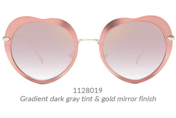 Pink metal heart-shaped sunnies are super sweet with a hint of edge. Shown with gradient gray tint. Frame #1128019.