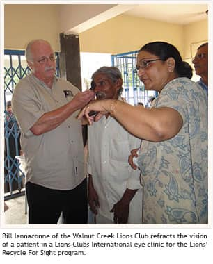 Bill Iannaconne of the Walnut Creek Lions Club refracts the vision of a patient in a Lions Clubs International eye clinic for the Lions' Recycle For Sight program.