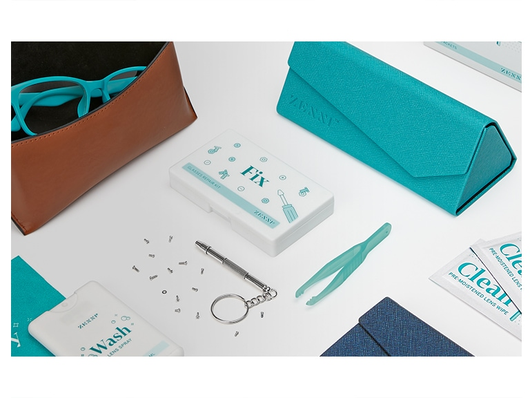 A pair of teal glasses in an open deluxe case in brown #A50100015, deluxe tri-fold case in teal #A90100124, Wash & Dry cleaning spray kit #A110200030, tweezers and screwdriver from Fix repair kit #A110400030, and individual Clean lens wipe packets #A110300030.