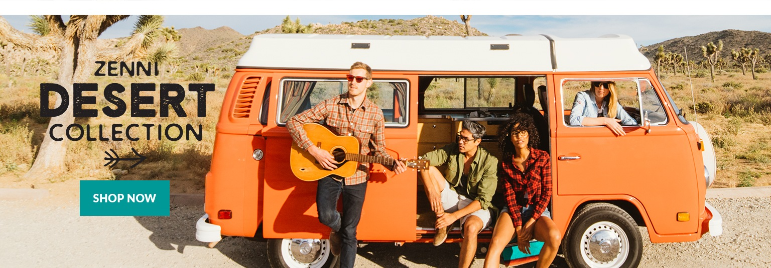 Two young couples hang out around orange VW van wearing sunglasses from Zenni's Desert Collection with Joshua Tree National Park in background.