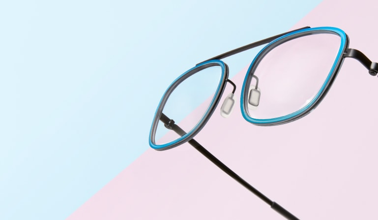 Floating pair of bridgeless rectangle glasses #7818116 with teal metallic rims.