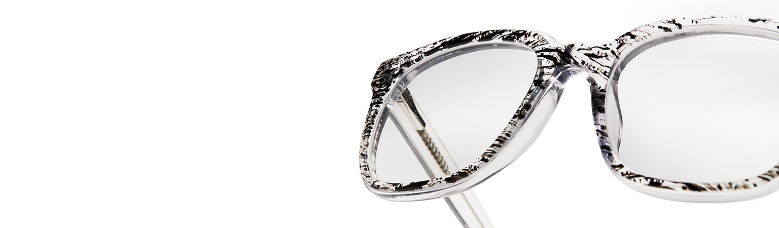 Clear acetate square glasses #4428623 with black-and-clear patterned layer over front rim floating against a white background.