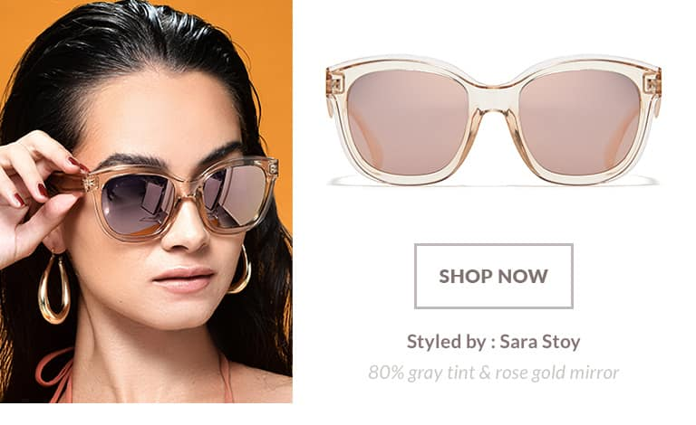 Model styled by Sara Stoy wearing premium square sunglasses #1116222 in translucent amber with 80% gray tint and rose gold mirror finish.