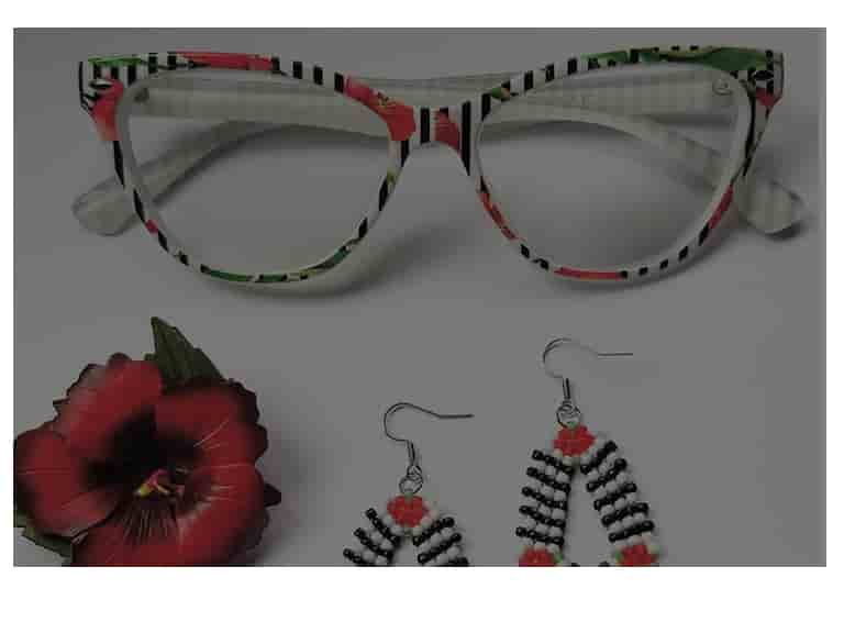 Bold yet feminine cat-eye glasses #129839 with coral-colored floral pattern and black stripes shown with matching beaded loop earrings and red hibiscus flower.