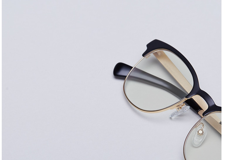 7cd567827e4 Black browline glasses with gold temple arms and Blokz blue blocker lenses.