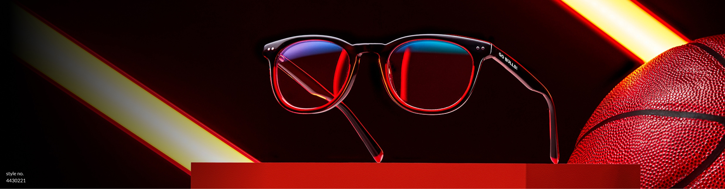 Zenni black and red round glasses Rim Rocker #4430221, displayed on a red platform next to a basketball.
