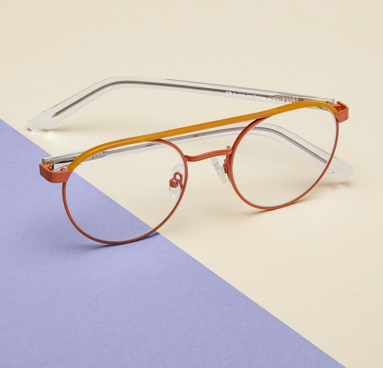 Image of Zenni orange aviator glasses #1913042 I am brave, against a cream and lavender background.