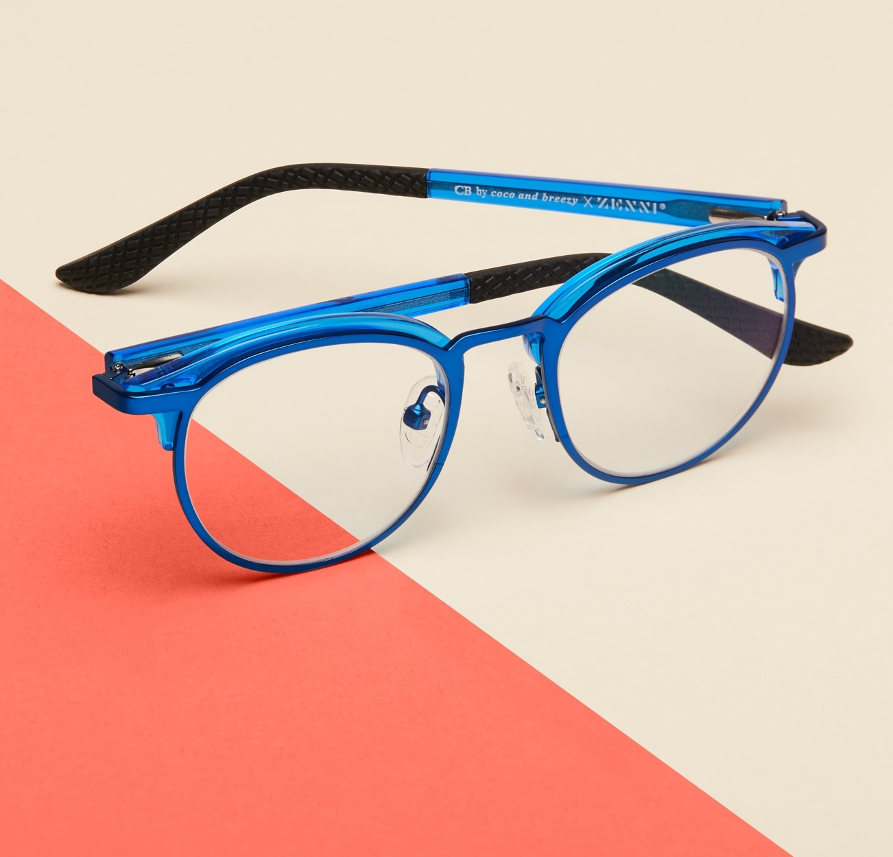 Image of Zenni blue round glasses #1912916 I am kind, against a cream and orange background.