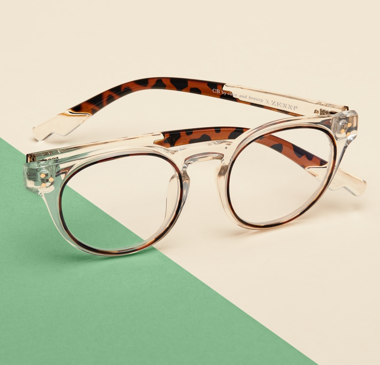 Image of Zenni clear square glasses #2034123 I am positive, against a cream and green background.