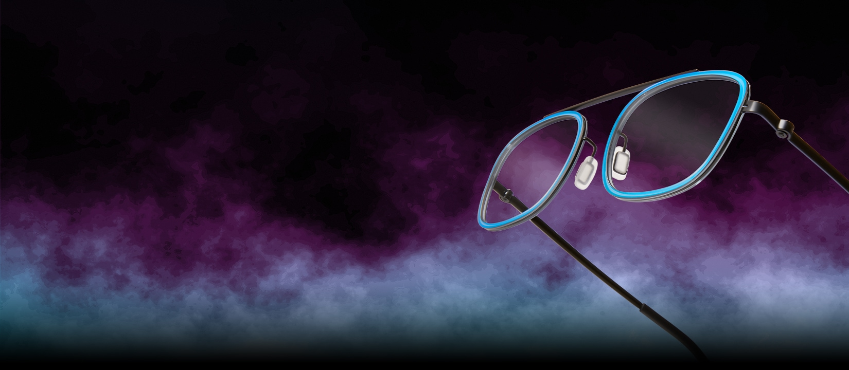 Zenni Gaming. Play longer. Play stronger. Armor your eyes. Image of Zenni rectangle glasses #7818116 against a black background, surrounded by colorful fog. Protection. Reduce eyestrain by blocking blue light with Zenni's blokz lens technology. Lightweight. Comfortable glasses with virtually no color distortion. Options. Find a style that is uniquely you. Affordable. Quality non-prescription and prescription gaming glasses for under $50.