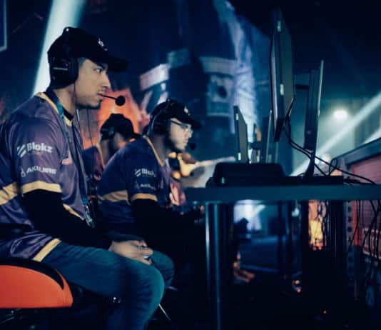 Image of a Lux Gaming member with a headset playing video games.