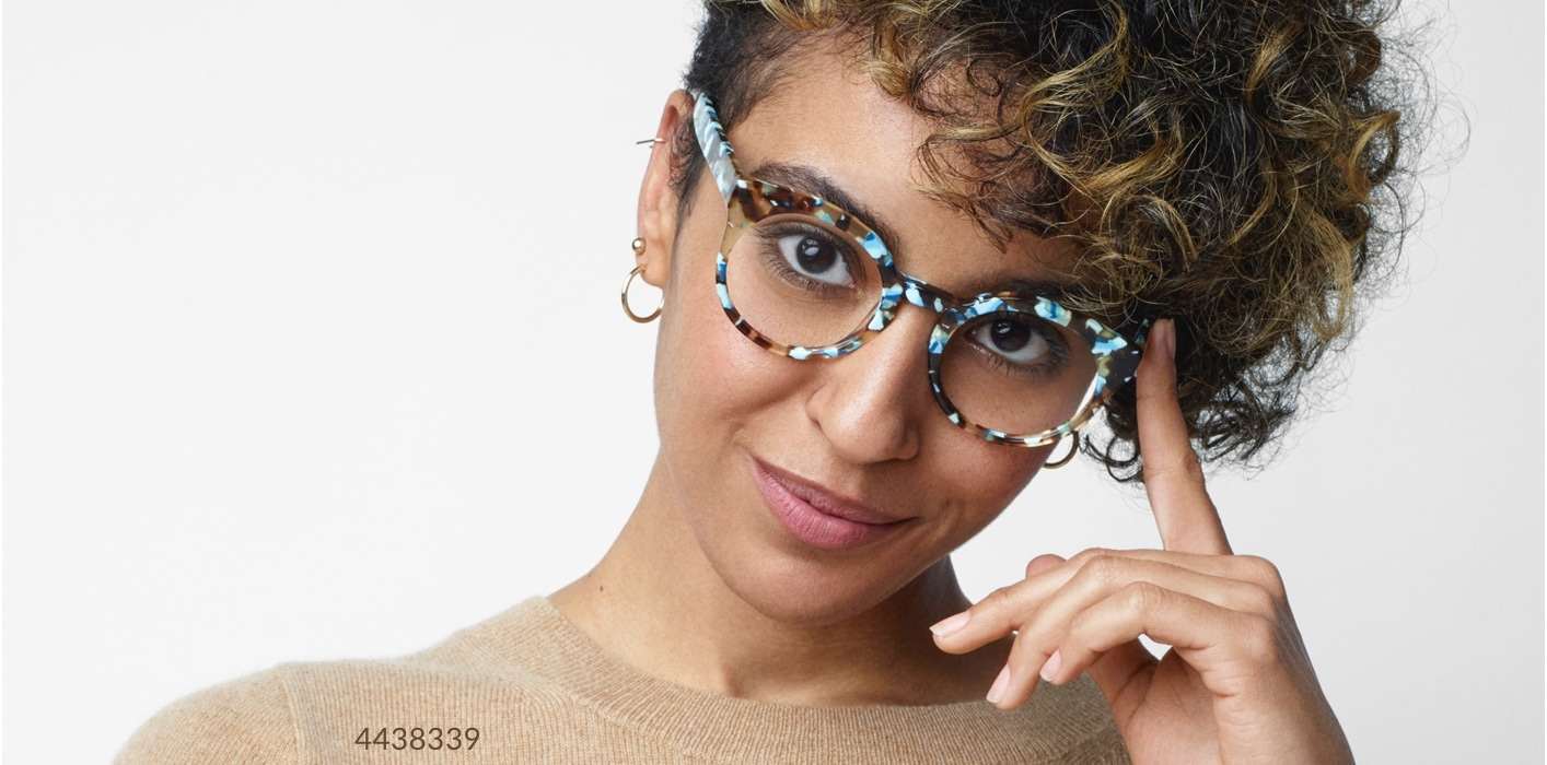 Prescription glasses starting at $6.95 (compare to $99). Shop now. Image of a woman wearing Zenni Round Glasses #4438339 against a gray background.