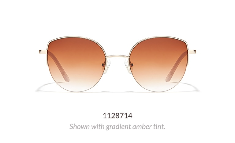 These wide cat-eye frames have a metal half-rim and metal temple arms with acetate temple tips. Shown in gold with gradient amber tint.