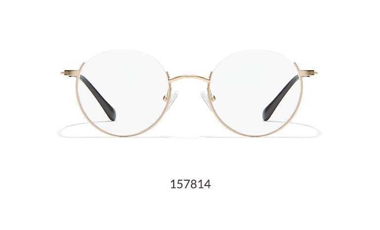 "These round gold metal glasses feature a striking ""reverse half-rim"" design."