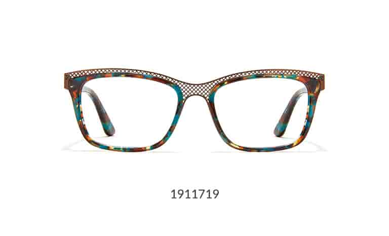 These statement glasses feature an acetate rim and temple arms, with a striking bronze mesh browline. The medium–wide frame has a glossy tortoiseshell pattern with flecks of teal blue.