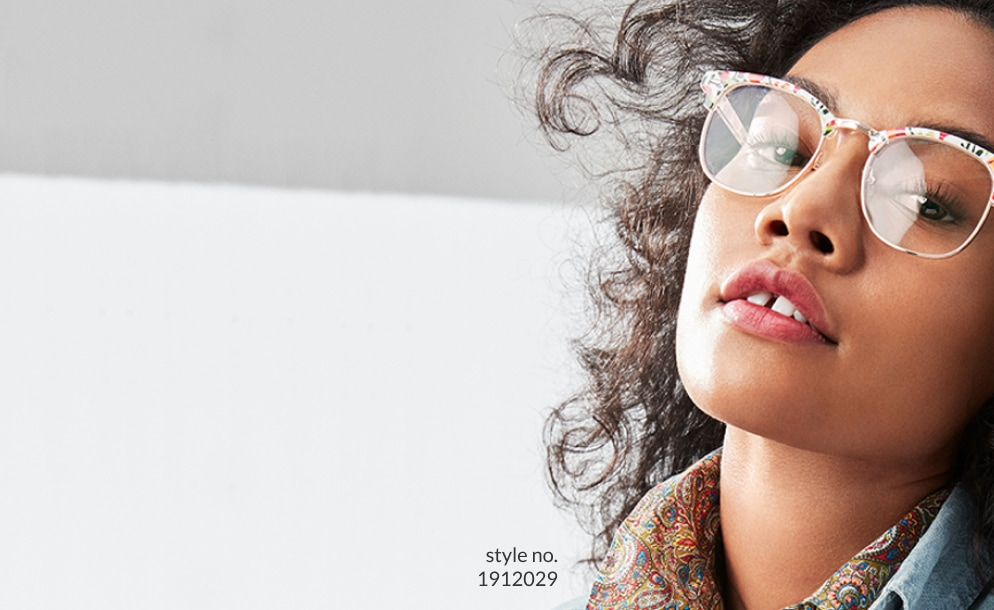 Image of a woman leaning back, wearing Zenni browline glasses #1912029.