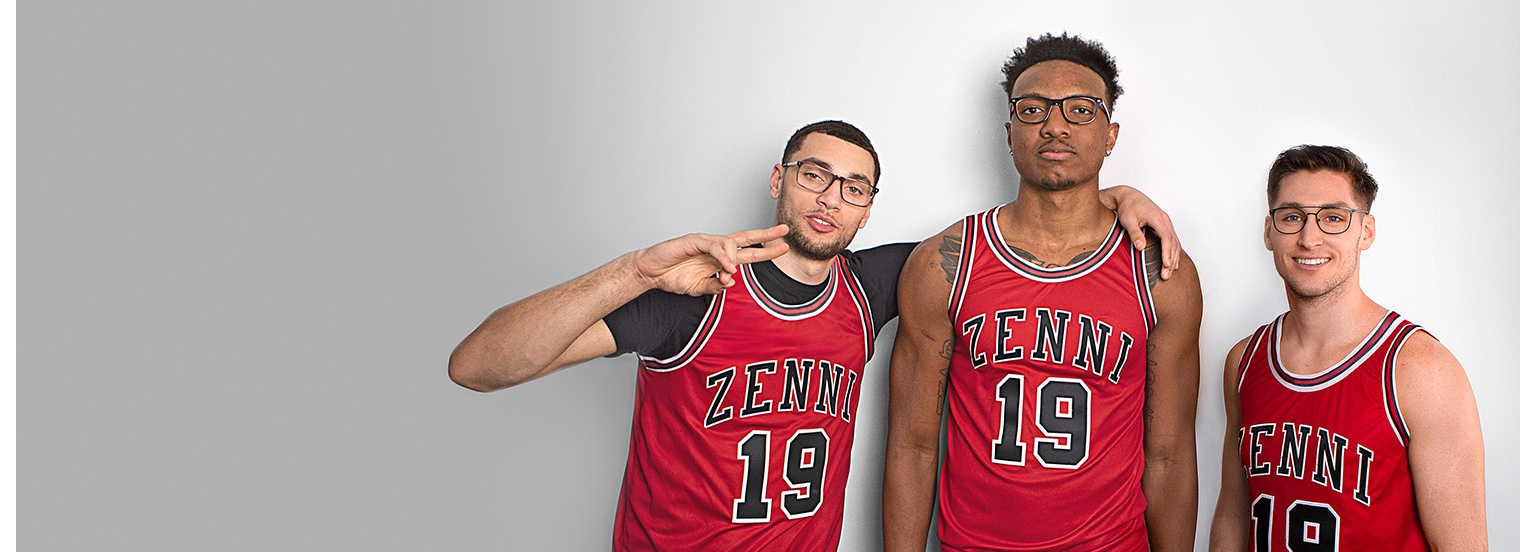 Zach LaVine of the Chicago Bulls wears a red Zenni basketball jersey and rectangle glasses #4440315 with his arm around Wendell Carter, Jr. of the Chicago Bulls, also wearing a red Zenni jersey and acetate square glasses #4443921. Next to Carter is Ryan Arcidiacono of the Chicago Bulls in a red jersey and metal square aviator glasses #3214021.