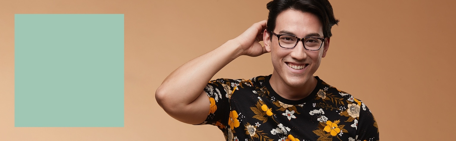 Man in a black floral t-shirt wearing tortoiseshell rectangle glasses #4439725.