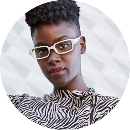 Woman with cropped afro wears white plastic rectangle glasses #2027430 with a zebra-patterned blouse.