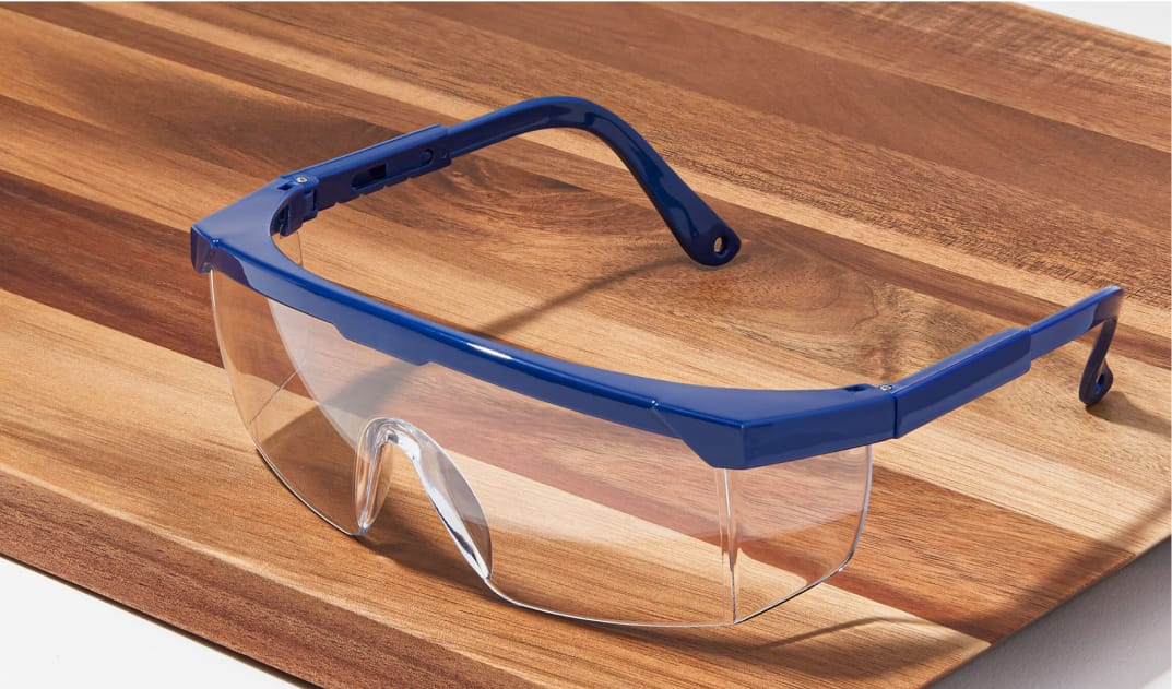 Image of Zenni protective goggles #A70180316 on a wood background.