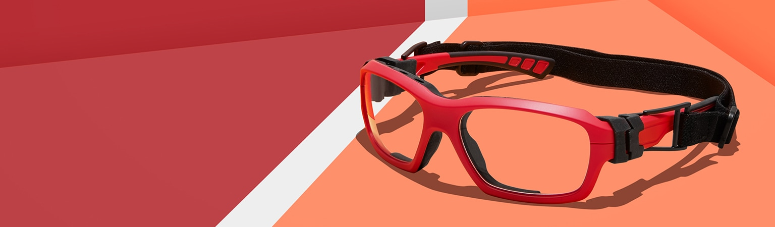 Play safe. Shop our selection of protective sport goggles that meet the ASTM F803-19 standard for basketball, soccer, badminton, and handball. Shop sport goggles. Image of Zenni sport protective goggles #743518, on an orange and red background.