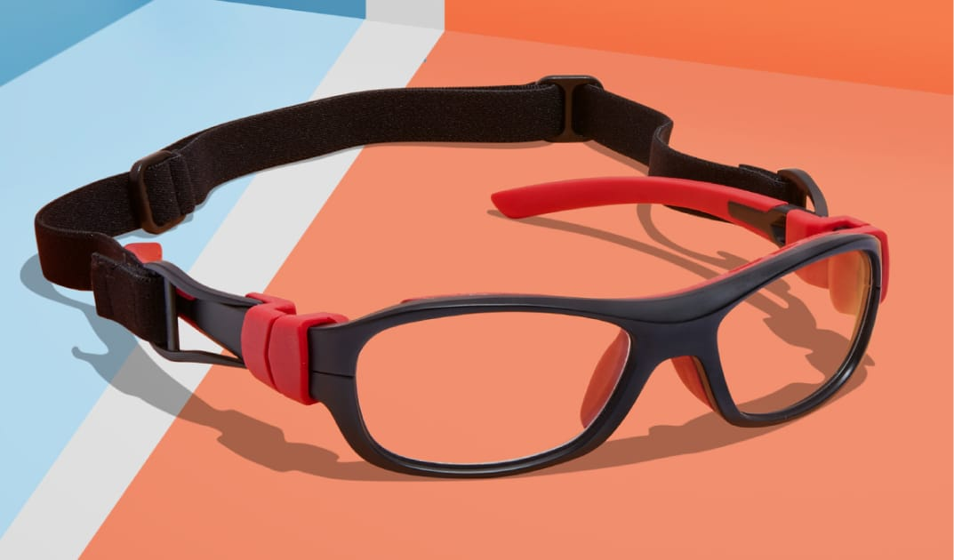 Image of Zenni sport protective goggles #743321 on an orange and blue background.