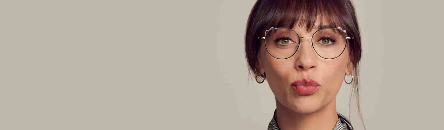 Actress Rashida Jones wearing silver metal cat-eye glasses #3219611.