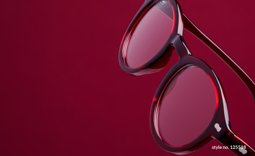 Image of Zenni round glasses #125518 against a rich red background.