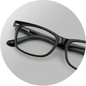 Image of a pair of black rectangular glasses against a gray background.