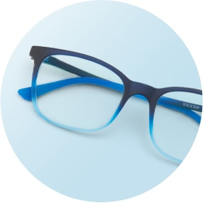 Image of a pair of blue square glasses against a light blue background.