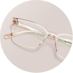 Image of a pair of beige rectangle glasses against a beige background.