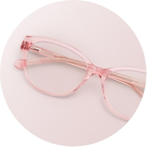 Image of a pair of pink square glasses against a light pink background.