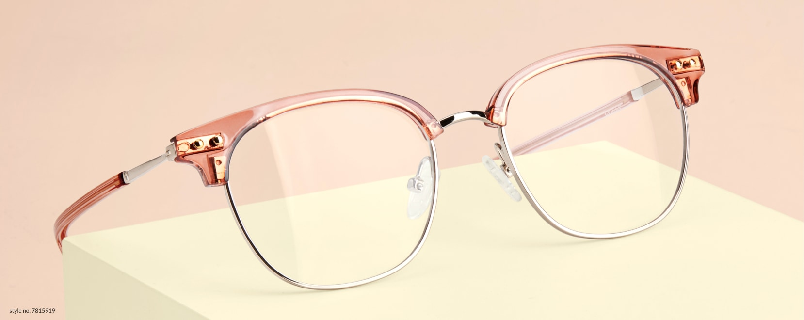 Image of zenni browline glasses #7815919, on top of a tan box against a pink background.