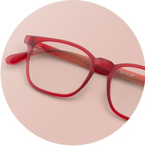 Image of a pair of red square glasses against a pink background.