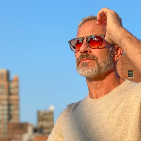 Garrett Swann wearing zenni premium square sunglasses #113121 with the sun shining on his face.