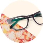 Zenni cat-eye glasses #4445521 on a cream-colored background with colorful accents.