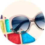Zenni premium geometric sunglasses #113619 on a cream-colored background with colorful tiled accents.