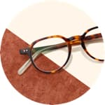 Zenni Escape round glasses #4430925 on a cream-colored background with brown accents.
