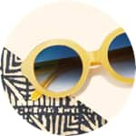 Zenni oval glasses #2023022 on a cream-colored background with tribal printed accents.