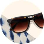 Zenni premium square sunglasses #113125 on a cream-colored background with blue tie-dye accents.