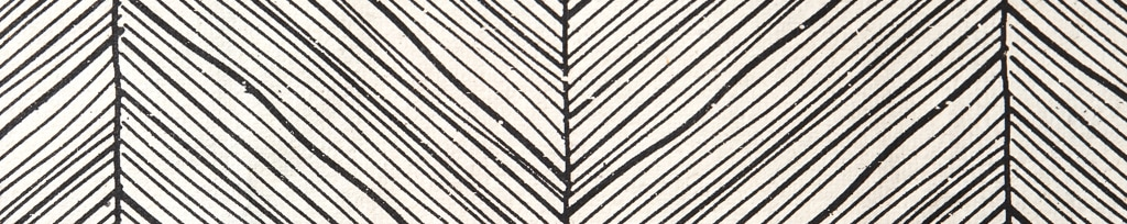 Simplicity, clean lines, and a monochromatic palette. Image of a black and white chevron pattern.