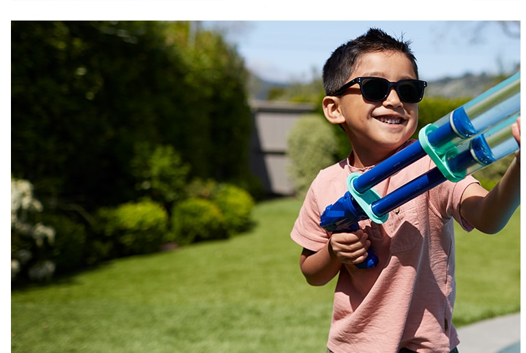 Photochromic lenses are clear indoors and darken in bright sunlight to protect your child's eyes outdoors.