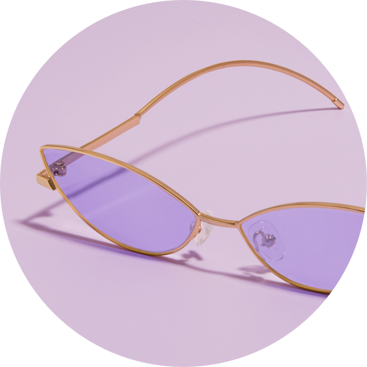 Zenni Premium Cat-Eye Sunglasses #1120914 in gold with lavender tint, against a lavender background.