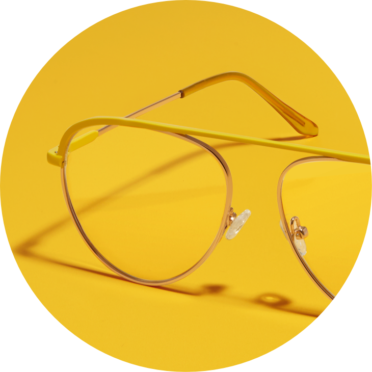 Zenni aviator glasses #3219722 in yellow against a mustard background.