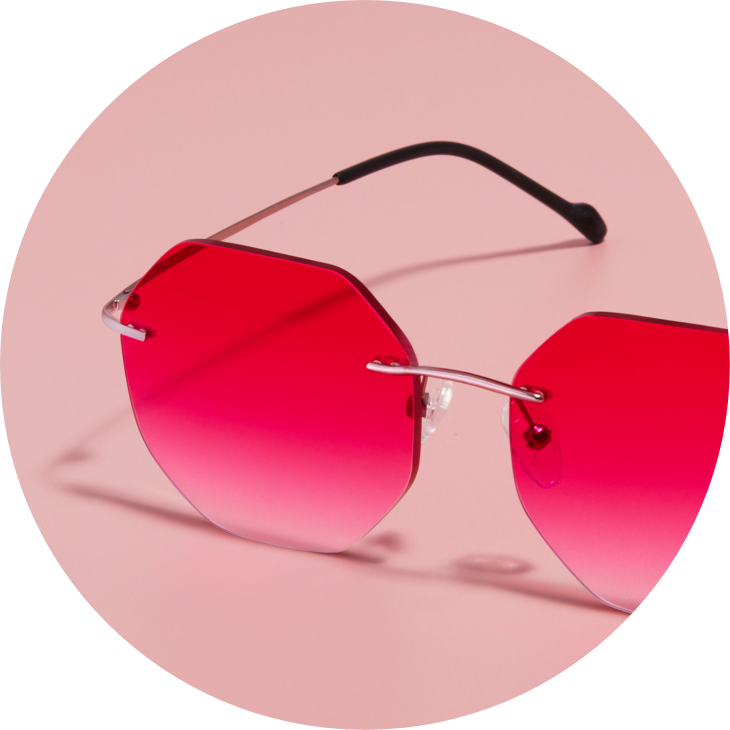 Zenni rimless glasses #3212719 in rose gold with pink gradient tint against a pink background.