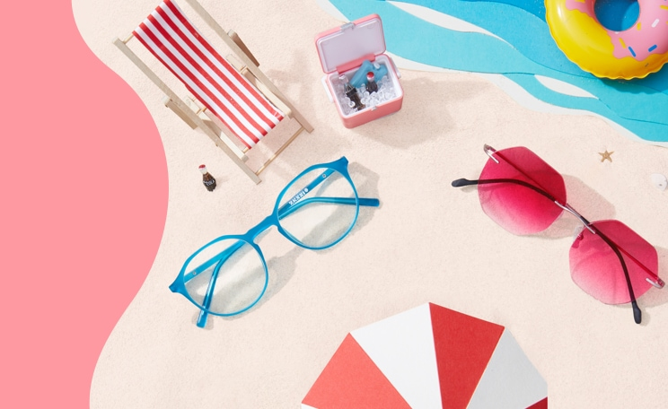 Summer Style. Get what's hot, all in one spot. Zenni round glasses #2020816 in aqua, and Zenni rimless glasses #3212719 in rose gold with pink gradient tint, in a beach setting with sand, water, a sun chair, and a beach umbrella.