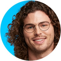 Man with curly shoulder length hair wears Laze round glasses #158121 in black from the TimoxZenni Out of Office collection.
